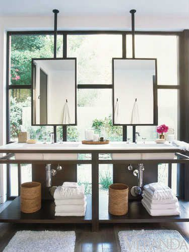 Love how window wall did not stop designer from adding the sinks and mirrors in bathroom