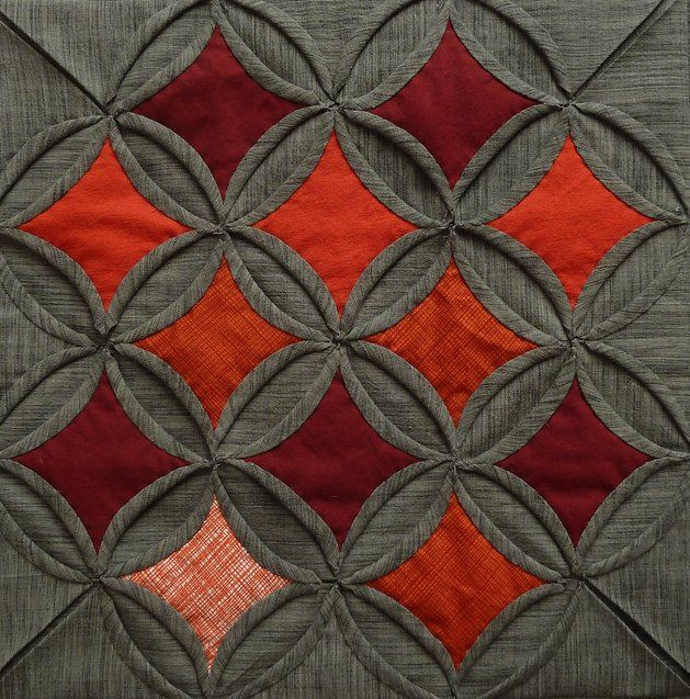 Alexis Deise. Cathedral window.  This is my favorite of all quilts.  One day...I will make one myself!