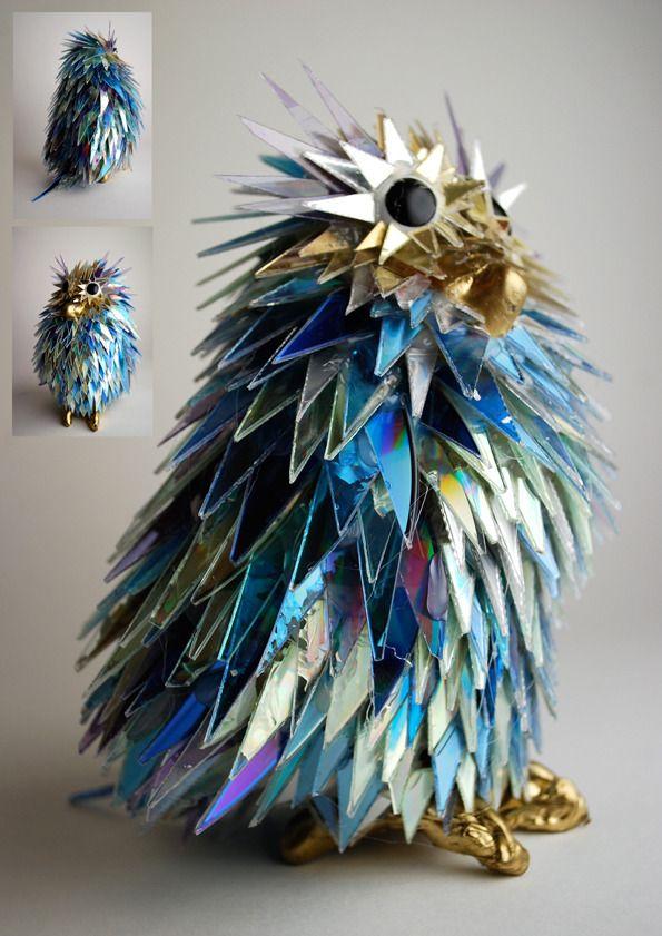Broken CDs transformed into iridescent animal sculptures. #art #tech #music