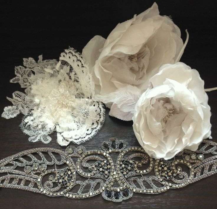 Daalarna Couture Lace flower, silk roses and a crystal belt.