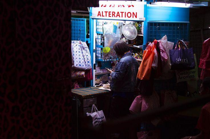 Alteration. Hong Kong street workers.