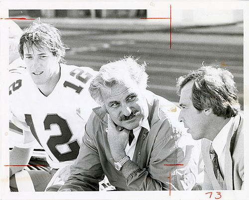 University of Miami coach Howard Schnellenberger with Quarterback Jim Kelly (left) and an unidentified assistant coach, via Flickr.