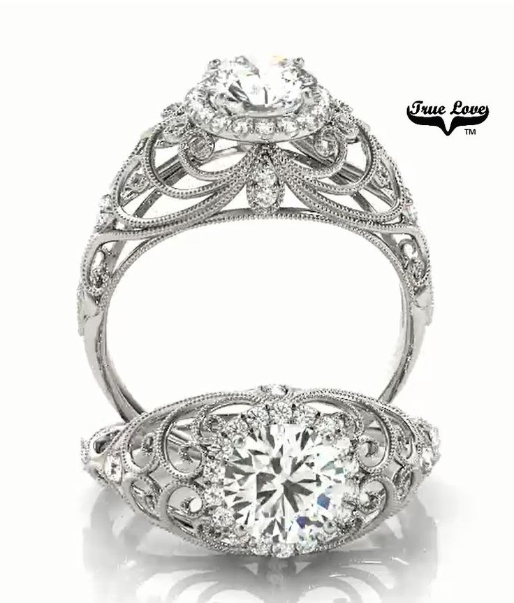 A stunning creation 14 kt.White Gold Halo 1.03 Carat Round Forever One Moissanite and Twenty Eight diamonds Engagement Ring.