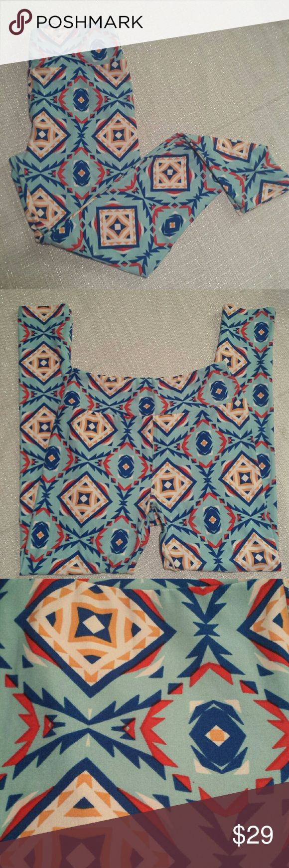 Lularoe Tribal Aztec Diamond Leggings OS Lularoe Tribal Aztec Diamond leggings. Robins egg blue background with Aztec tribal and diamond pattern in shades of red, royal blue, goldenrod and white. Great condition with no rips, holes, tears or stains. Bright pattern. No fading. One size. LuLaRoe Pants Leggings
