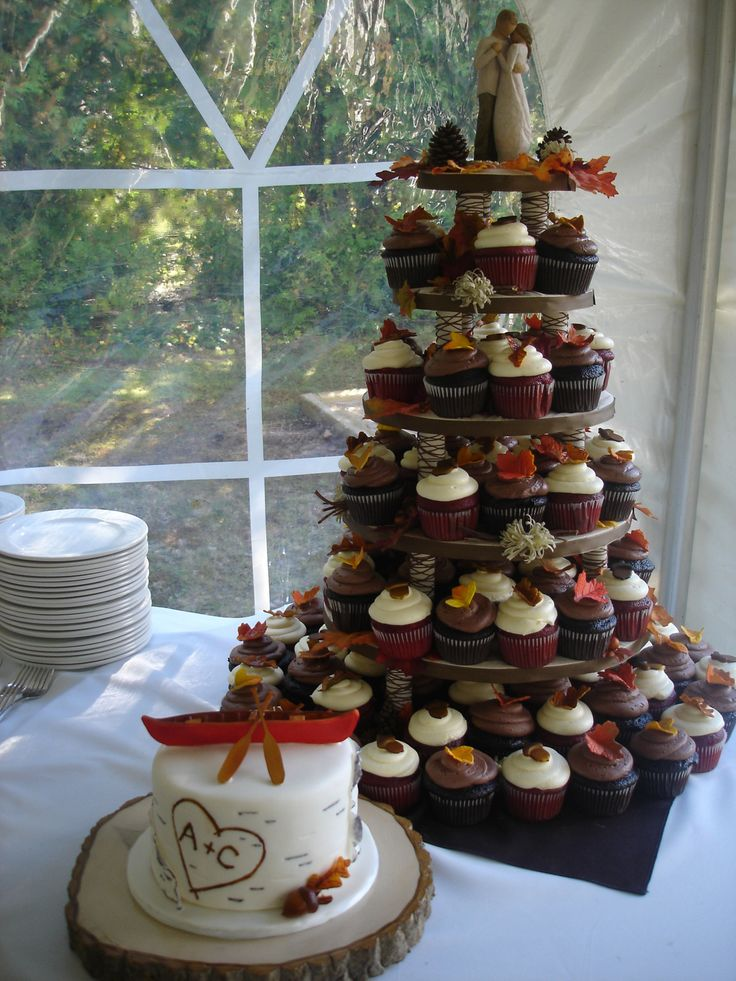 Fall wedding cupcakes, Love the little cake for the bride and groom and I love the leaves on the cupcakes!  Just use the different cupcake stand!