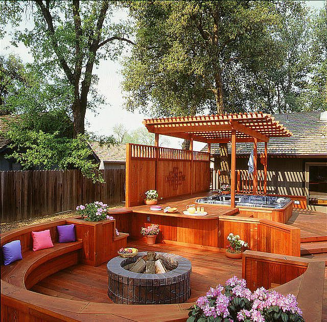 deck with fire pit and hot tub area