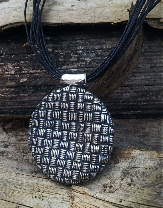 Sterling silver African weave round pendant on leather multi-string