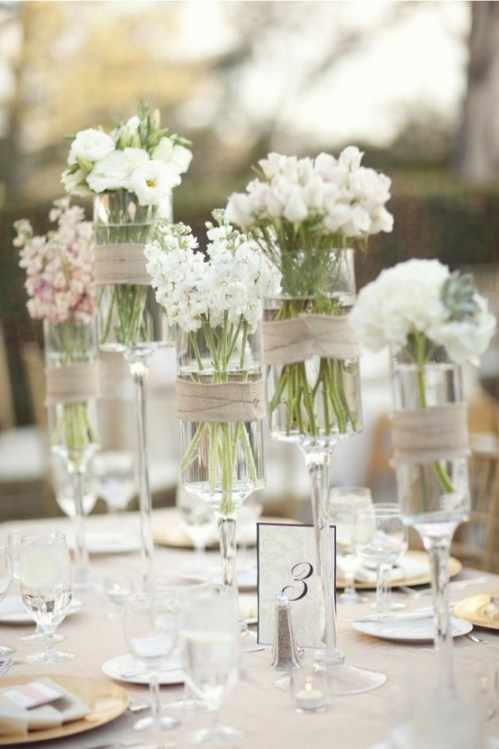 I like the clear vases with ribbon