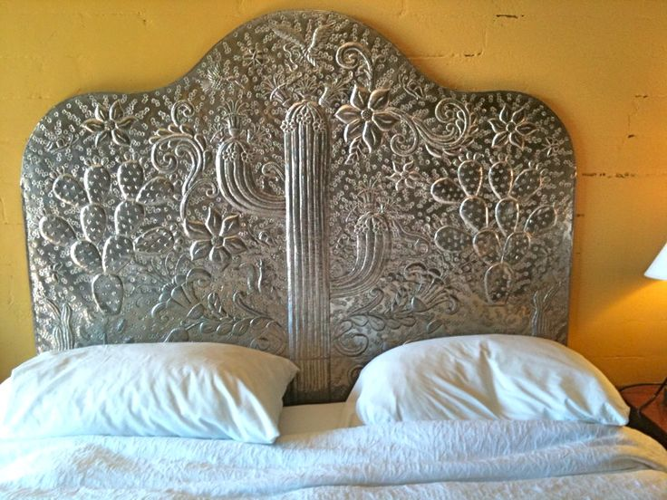 Mexican tin headboard in our hotel room in Tucson, AZ- loved it! (photo by Olivia) - for vintage Mexican items for your home, visit www.mainlymexican.com #Mexico #Mexican