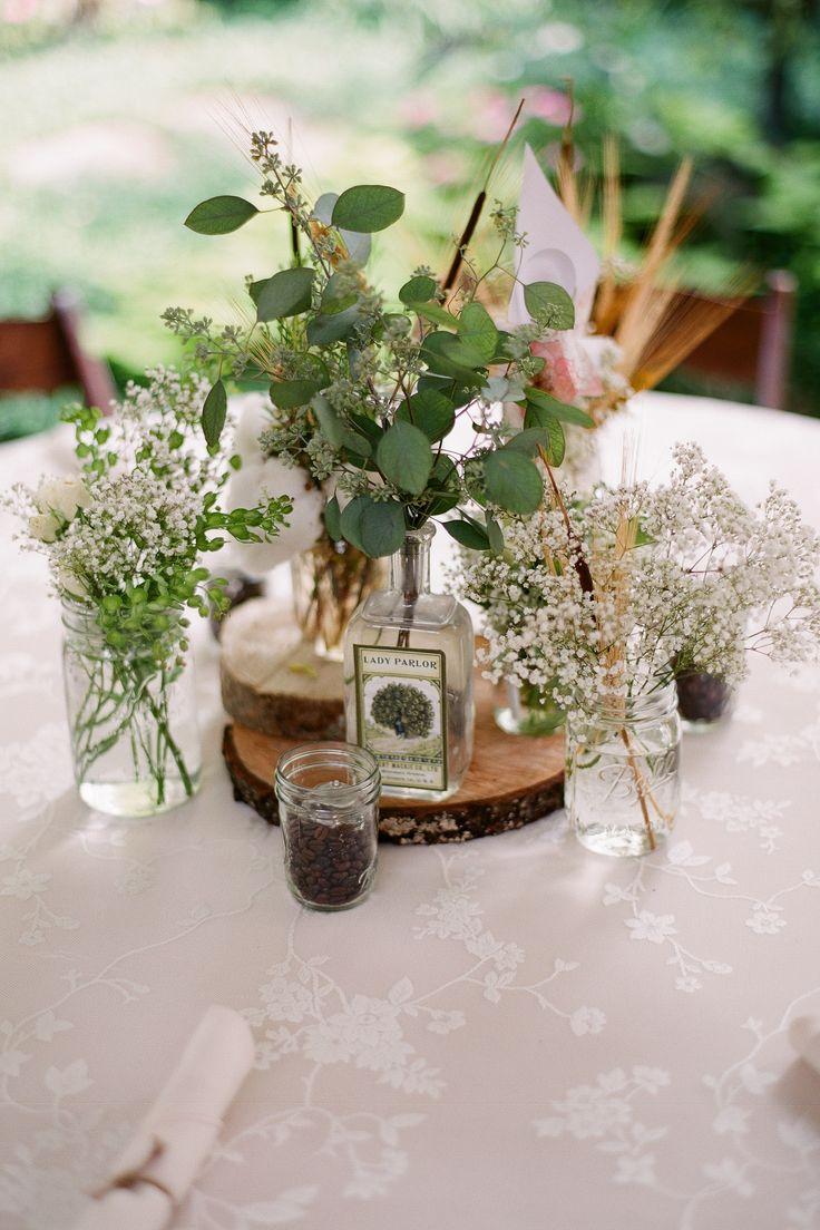 Garden wedding venue cotton eucalyptus logs wheat