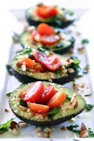Mini Avocado Salads - 4 Avocados, 15 baby tomatoes, chopped, 1 garlic clove, chopped, 1/4 teaspoon salt, 1 tablespoon chopped fresh cilantro, squeeze fresh lime juice, fresh ground pepper.