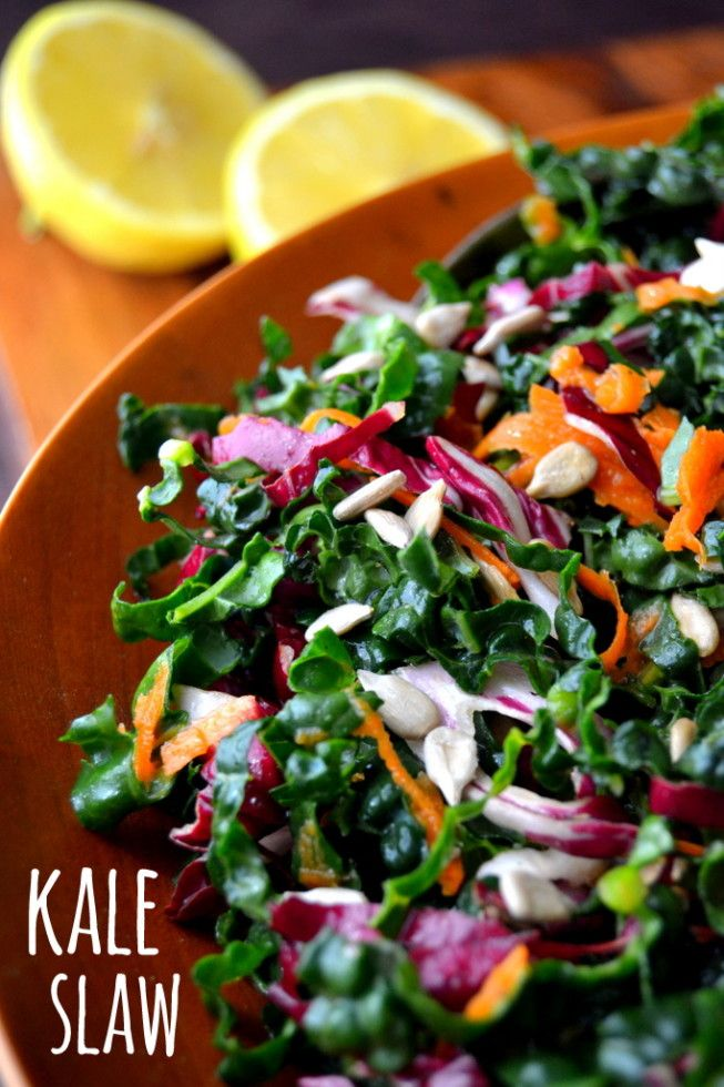 Kale Slaw with Lemon Sesame Dressing..1 bunch kale 1 carrot, 1/2 small head of radicchio (substitute red cabbage) 1/3 cup sunflower seeds feta or goat cheese for garnish (optional) dressing 1/8 cup sesame oil juice of 2 small lemons 1 Tbsp honey 1/2 tsp Dijon mustard salt and fresh cracked pepper to taste