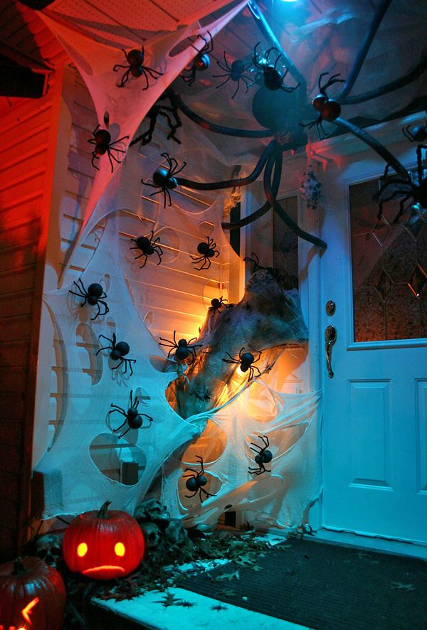 Front Porch Halloween Decorating Ideas | This one is just an inspirational idea, done with discount store spider webs and spiders… Great idea for how to lay out a real spooky front porch! Lighting is key!