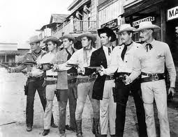 Warner Brothers western TV stars 1958  From left to right: Will Hutchins, Peter Brown, Jack Kelly, Ty Hardin, James Garner, Wayde Preston, and John Russel