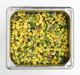 ROASTED CHILI CORN Qdoba Copycat Recipe 6 ears of yellow corn 2 poblano chilies 2 jalapeno peppers 1/2 red onion, diced 1/3 cup ...
