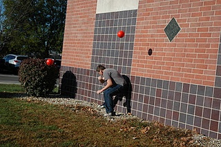 Hunger Games activity: dodging the fireballs. And, yes, you are out if it bounces off the wall and hits you. It's a fireball.