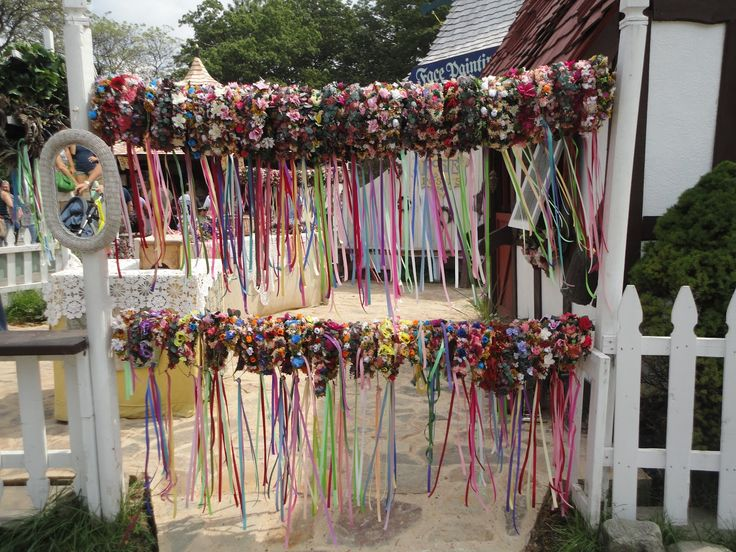 Floral Wreaths For Sale At A Renaissance Festival. Inspiration For A  Ceremony Backdrop.
