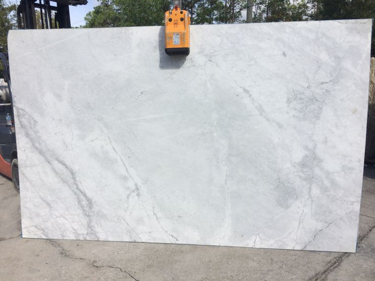 Super White #granite features smooth patterns of gray across a white background. Super White slab is high variation #naturalstone which is perfect #granitecountertops for light and dark color #kitchencabinet or #kitchenisland.