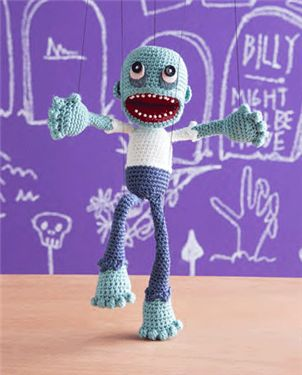A crochet amigurumi puppet zombie