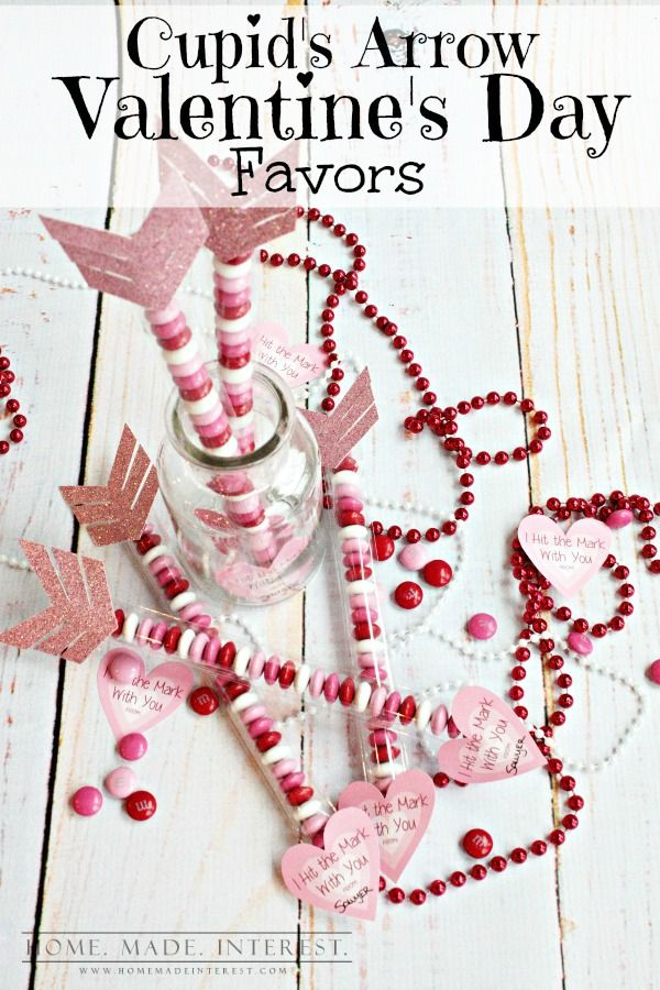 This Cupid's Arrow Valentine's Day Favor hits the mark! With a pink heart and Valentine's Day M&Ms this is a great kid's Valentine's Day classroom favor and even adults won't be able to resist a this simple Valentine's Day craft.