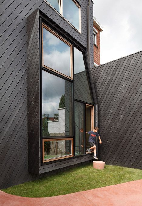 Assorted Windows And Diagonal Cladding Feature On Renovated Home By NU Architectuuratelier - http://decor10blog.com/decorating-ideas/assorted-windows-and-diagonal-cladding-feature-on-renovated-home-by-nu-architectuuratelier.html