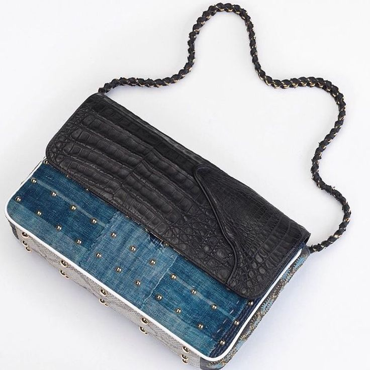 Late 1800s Sashiko indigo, black crocodile, 19th silk dragon with handstitched Lesage embroideries on the side #maisonravn #handbags #unique #bag #incomparable #handcrafted #luxury #oneofakind #instagram #crocodile #silk #exclusive #france #paris #art #musthave #clutch #art