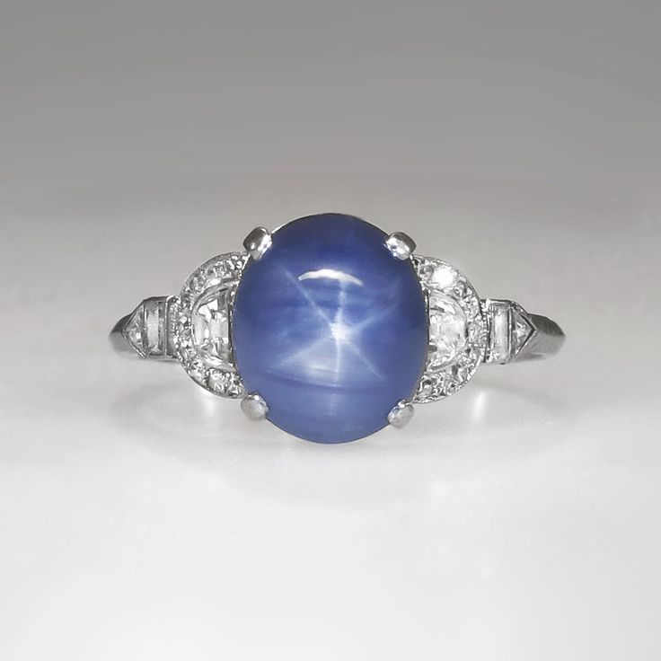 Rare Marcus & Co. 5.76 ct t.w. Lavender Blue Star Sapphire & Diamond Ring Platinum | Antique & Estate Jewelry | Jewelry Finds Price: $6850.00  Here is an authentic and original 1930's 'Marcus & Co.' museum quality heirloom ring! A highly valuable and rare Marcus & Co. star sapphire, diamond and platinum ring from the early Art Deco era. This designer and artist is even more sought after than Tiffany & Co. and Cartier pieces from it's time