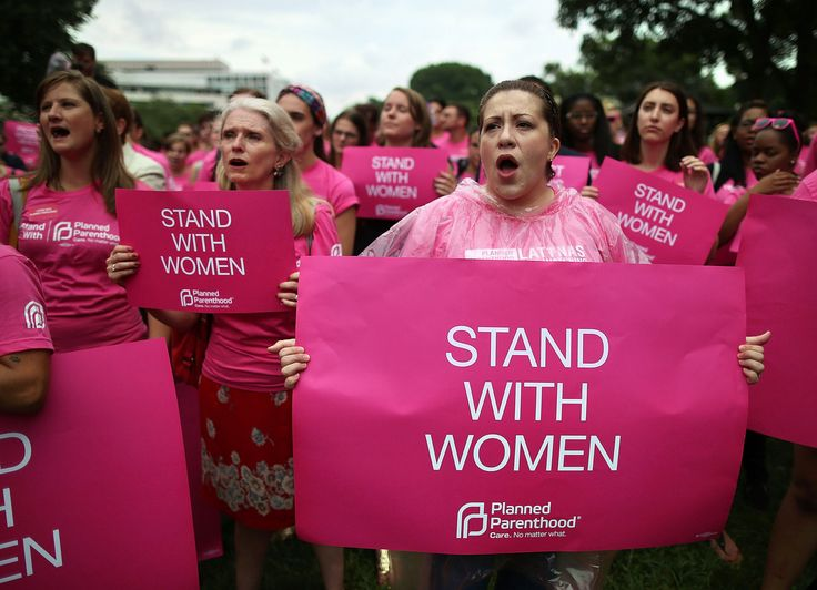 2013: Women hold up signs during a women's pro-abortion rights rally on Capitol Hill, July 11, 2013 in Washington, DC. The rally was hosted by Planned Parenthood Federation of America to urge Congress against passing any legislation to limit access to safe and legal abortion. (Photo by Mark Wilson/Getty Images)