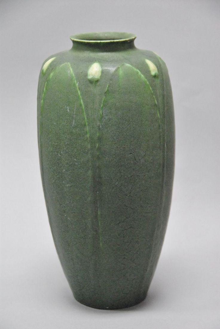 Rare Grueby Faience Co. Ruth Erickson two-color pottery vase in matte green glaze with alternating leaf and white molded flower bud design, circular stamp Grueby Faience Co. Boston U.S.A. and Artist's initials RE (three minor chips/bruises). - Realized Price: $5,880.00