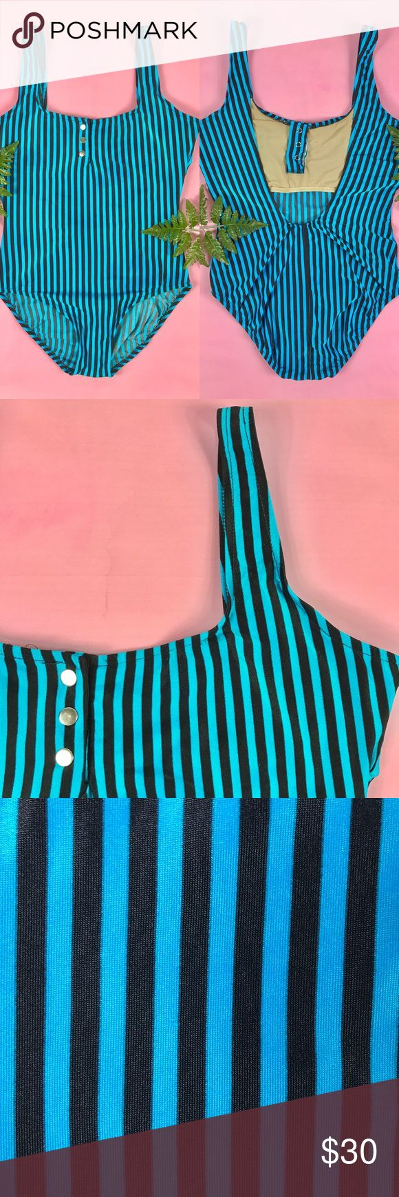 "Vtg 80s one piece striped bathing suit 🌴👙💦 cute 1980s blue and black vertical striped one piece swim suit! low cut back and high cut legs for that ultimate 80's look. three functional snap buttons. made by ILGWU. excellent vintage condition, no noted flaws!  FEATURES: label - Avon Fashions size labeled - 13/14 made of - 85% nylon/15% spandex made in USA  *keep in mind vintage sizes sometimes vary from todays*  MEASUREMENTS:  laying flat, double when appropriate 28"" length 18-21"" bust…"