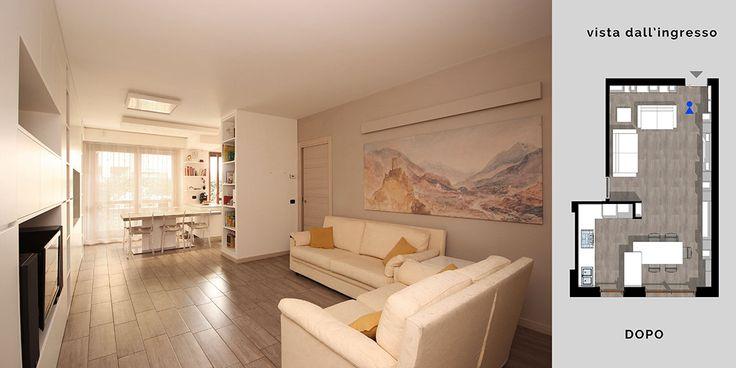 Sulla parete lasciata libera dai mobili trovano spazio una luce lineare realizzata su misura che illumina l'ambiente, e un grande quadro posizionato proprio sotto di essa. na giorno e cucina-pranzo.