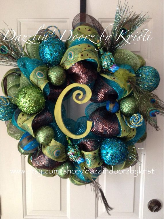 Absolutely gorgeous Peacock themed wreath made from turquoise and olive green Deco mesh and brown and green Peacock ribbon. This wreath has