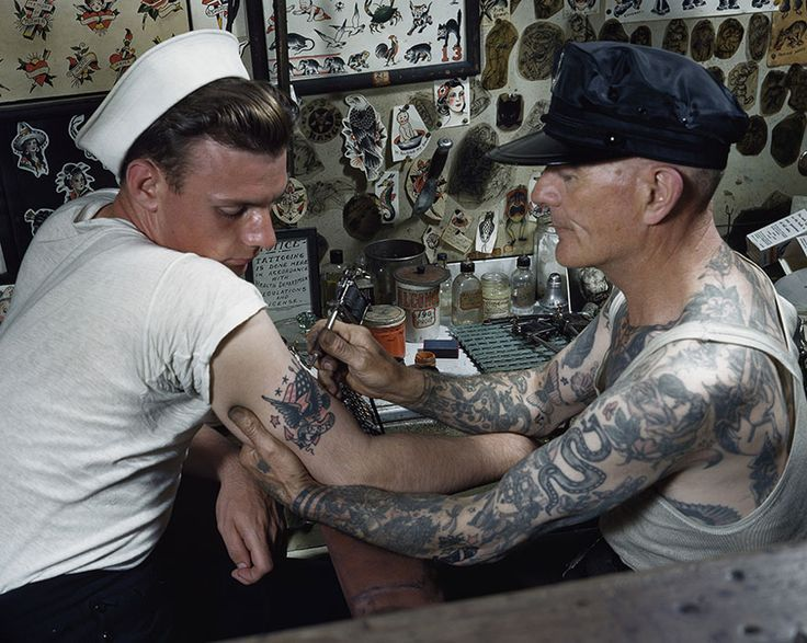 A Sailor Gets A Tattoo On His Arm In Virginia