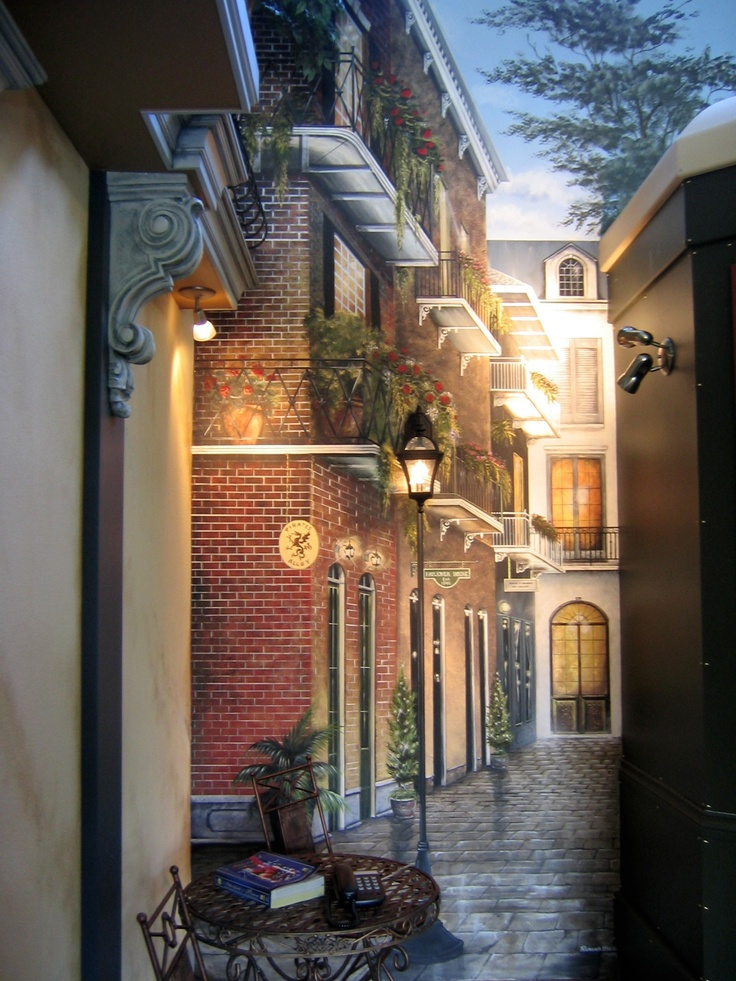 Two story tall mural of Pirate's Alley New Orleans by Ramona Balaz-Schmidt