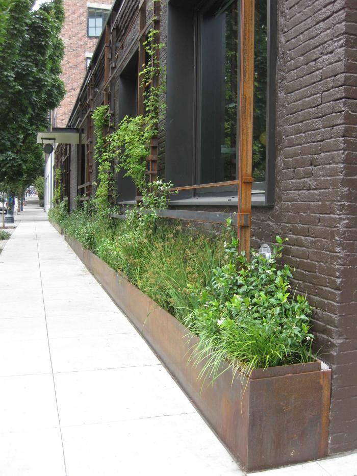 Corten Steel Planter Retaining Wall System - balcony with bamboo & lemon grass