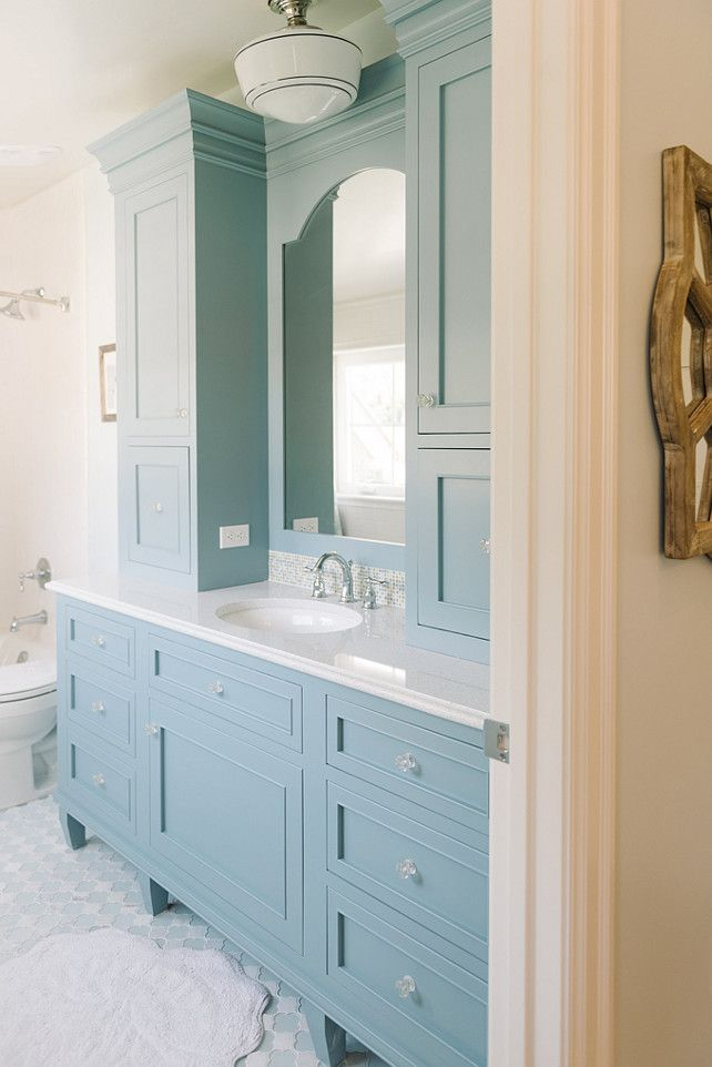 vanity painted Benjamin Moore Cornflower Blue adorned with glass knobs  topped with white quartz fitted with a white porcelain sink under a blue  arched ... - Best 25+ Blue Vanity Ideas On Pinterest Blue Bathroom Interior