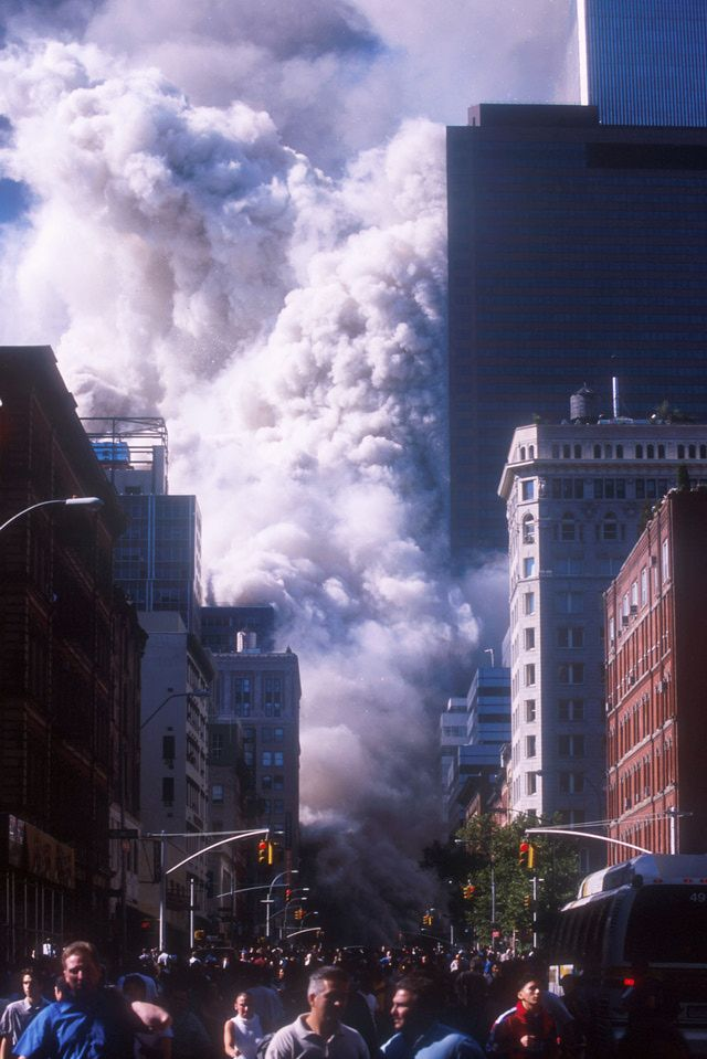 9-11 Photos--Attack on the World Trade Center.  People flee the New York World Trade Center after the towers collapsed.