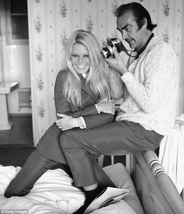 Sean Connory takes a picture of Brigitte Bardot in Deauville, France, to film Edward Dmytryks 1968 western Shalako
