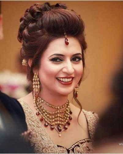 Elegant loose curl updo on Divyanka Tripathi |Image source Wedding Story | Curated by Witty Vows