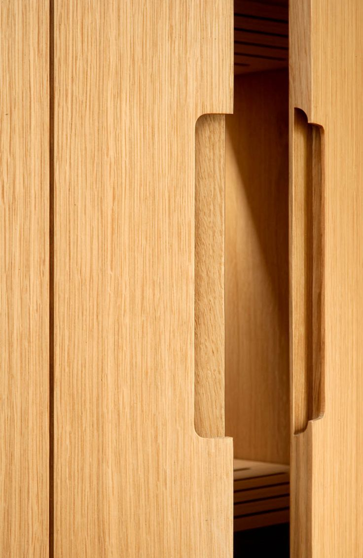 Beautiful joinery detail. Oak finger pull cupboard cut out groove.