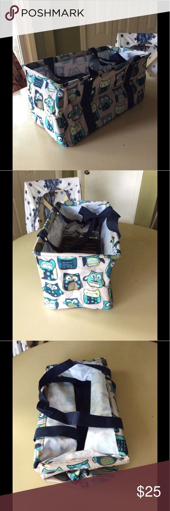 Thirty-One Owl Print Deluxe Utility Tote Bag Thirty One large carry all rectangle canvas utility tote with blue handles. New with original bag packaging. Put books in it to show how much it can hold when full, but it is brand new, never used. Thirty One Bags Totes