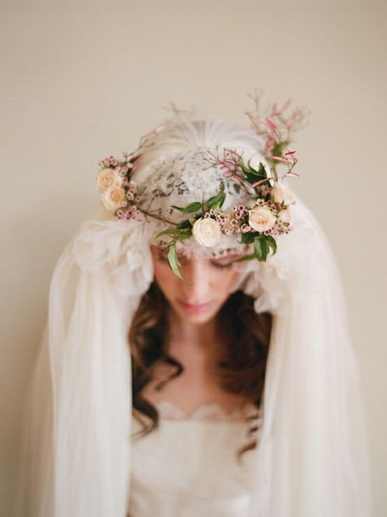 Gentle floral crown on a vintage veil for a sweet outdoor rustic wedding