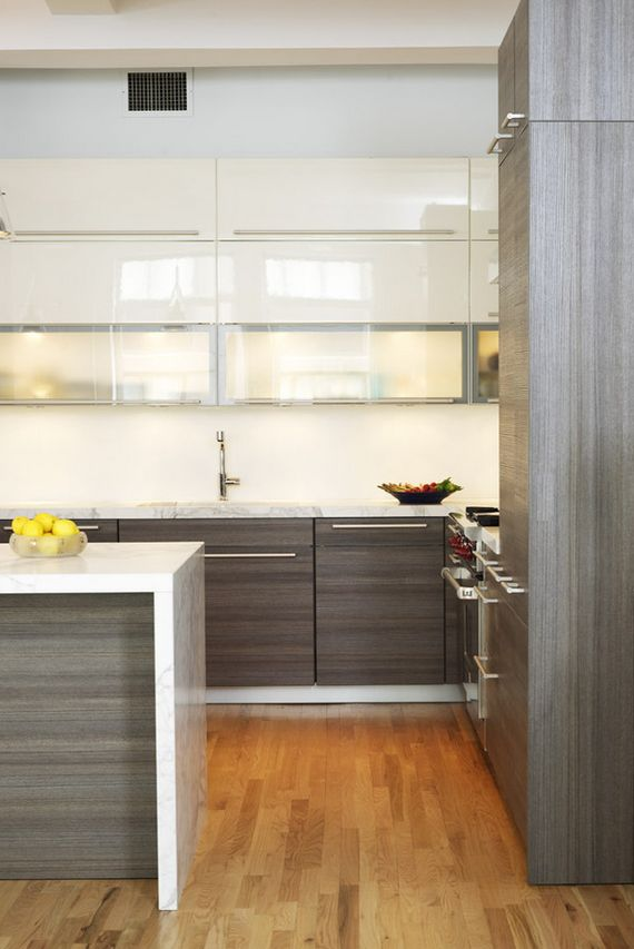 white cabinets up top, wood on bottom, waterfall countertop with seating, poggenpohl cabinetry