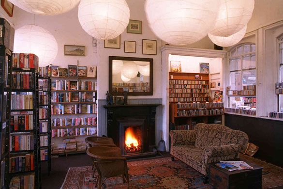 barter books, northumberland, england. how cozy would it be to curl up by that fire?