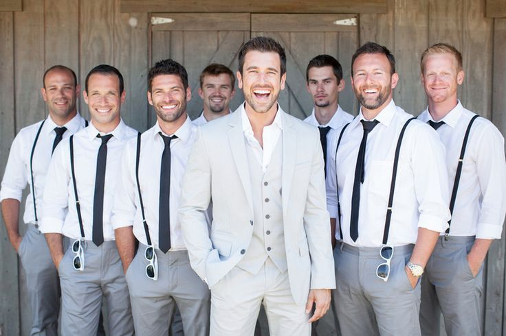 What about groom with white shirt, groomsmen with a shirt the color of the bridesmaid dresses...depending on the color.   Groom & groomsmen suits idea