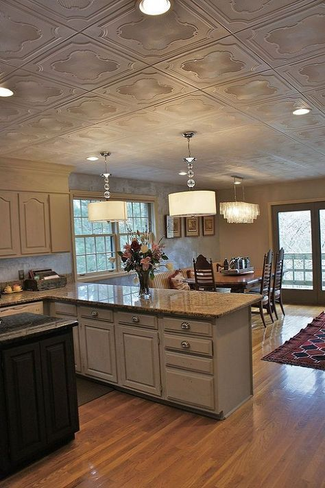Popcorn Ceiling Makeover- Low Budget, Big Impact with styrofoam ceiling tiles. Love the lighting as well!
