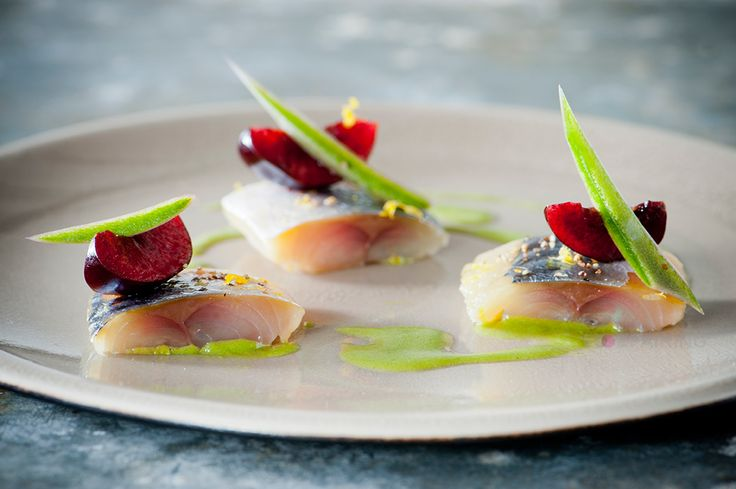 Summer ingredients come together in this tasty appetizer of Cured Mackerel served with Green Apple - Majii® Leaf vinaigrette and ripe cherries.
