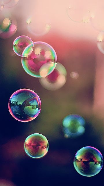 Bubbles have whimsical, magical, characteristics. I also love how light reflects on bubbles.