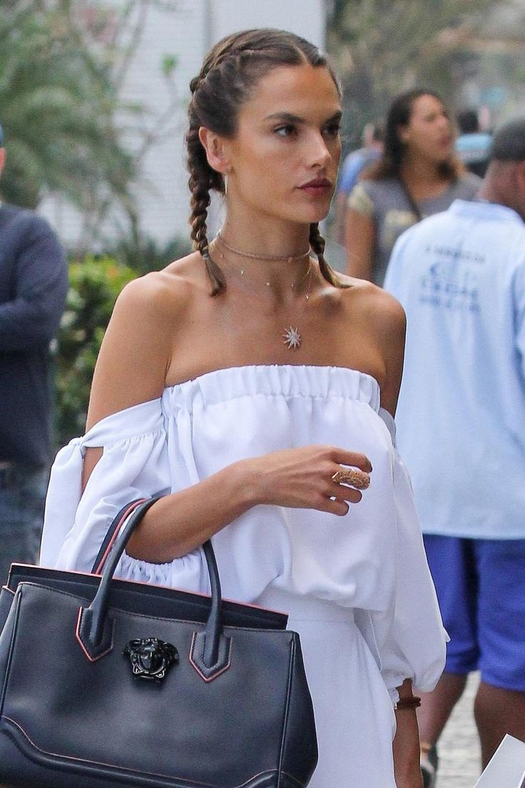 Alessandra Ambrosio supercharges her steamy allover glow with two slick, clavicle-grazing braids.