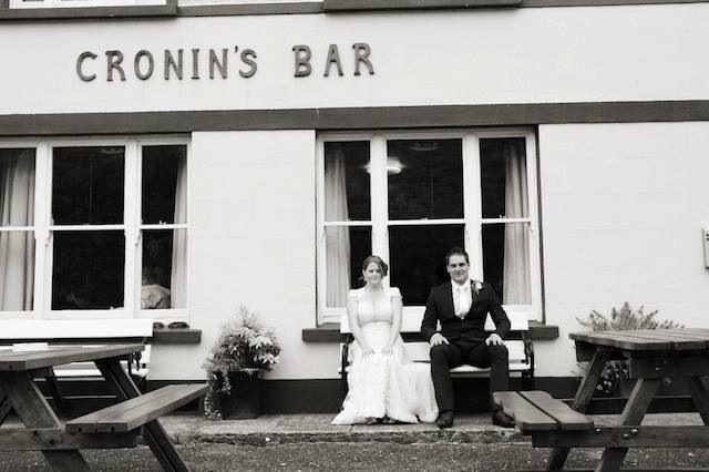 Suzette and Killian outside Cronin's Bar #wedding #romantic #vintage